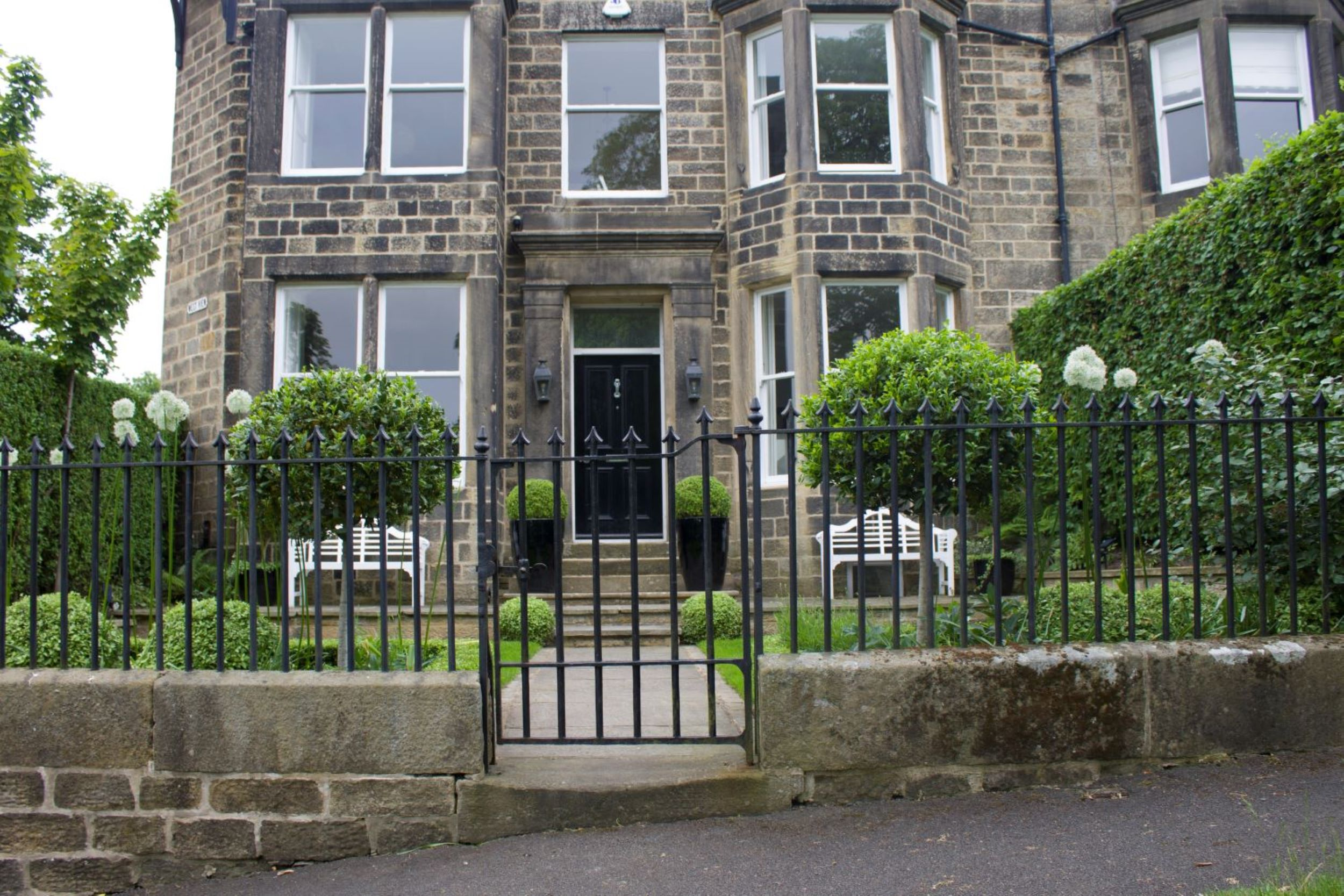 A formal front garden to a period town house, Ilkley.