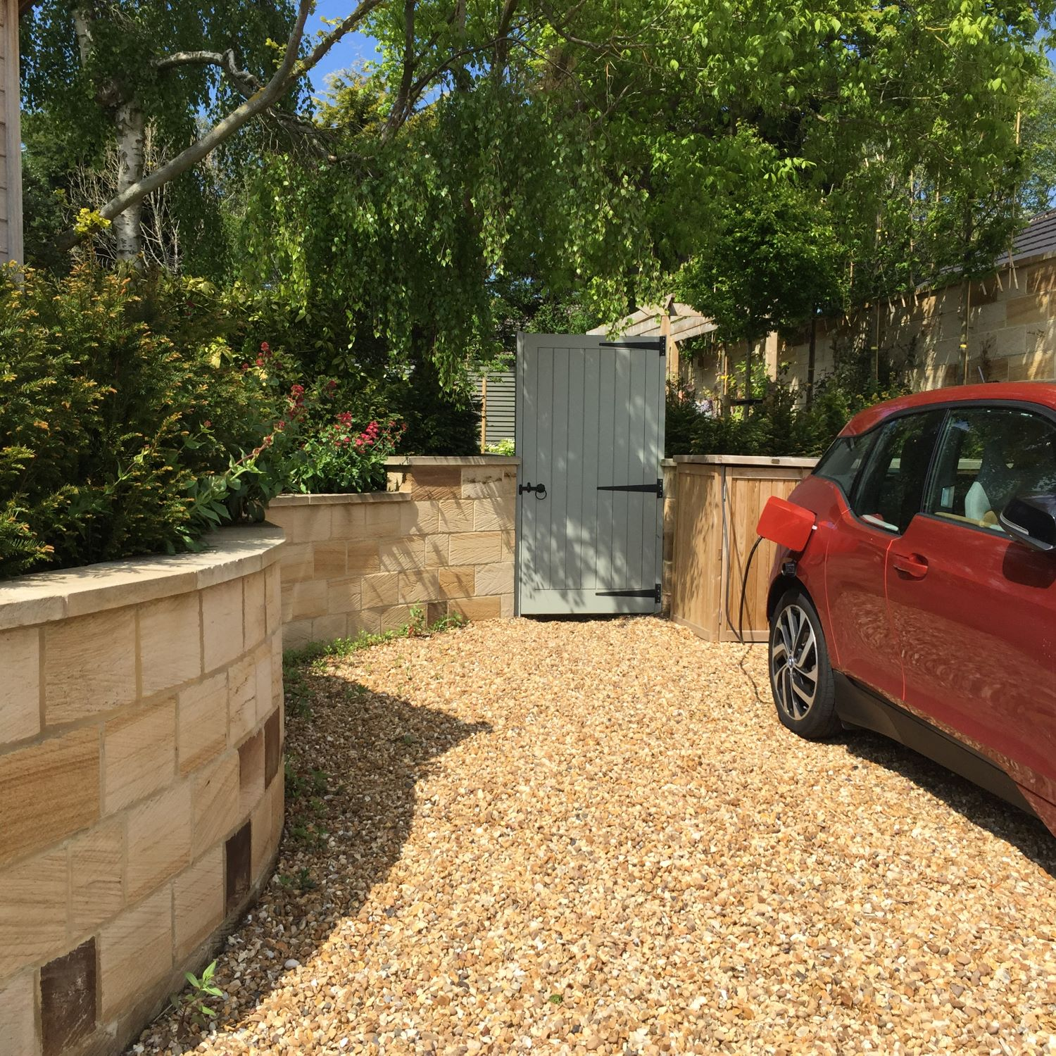 The timber bin stores and car charging point