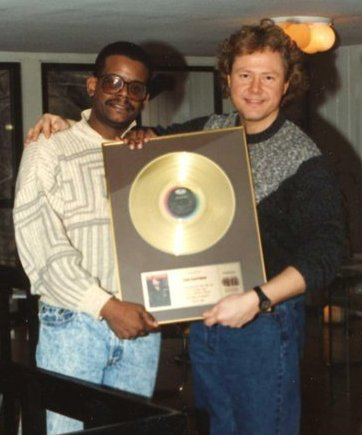 "Greg Johnson and Dan at his Westport, CT studio showing off the gold record for Joe Cocker's ""Unchain My Heart"" album; Photo courtesy Wally Smith"