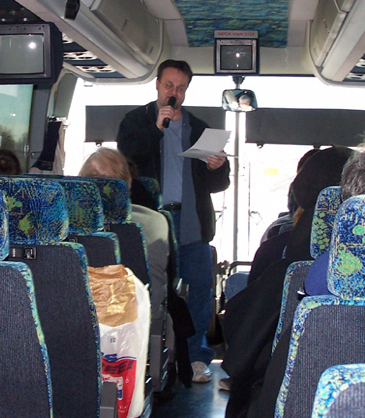 Speaking at the front of the bus while flying down the highway at 75 mph backwards. Never an easy task.
