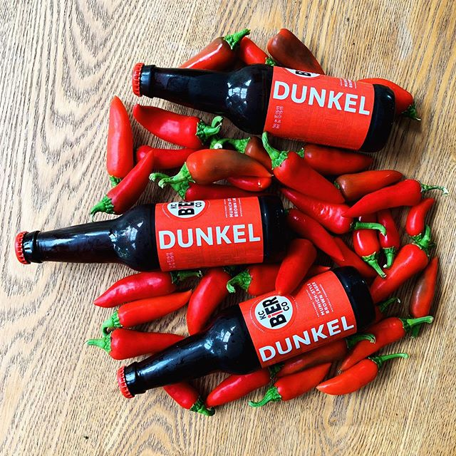 Hyperlocal hot sauce with homegrown fresnos and KC Dunkel! We made this the past two years with store bought and are so excited to harvest the peppers from the garden this year. #slamdunkel 🌶
