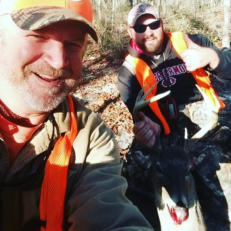 While dog-hunting in Mossy Head Dec. 30, 2016, Josh Cooper of Crestview (right) took this 8-point buck. He's pictured with Tommy Fortune.