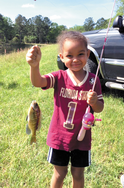 Choley Phillips of Crestview, age 4, hooked her very first fish April 15 on a private pond in Laurel Hill. The bluegill was caught on Phillips's new reel, and she even reeled it in by herself.