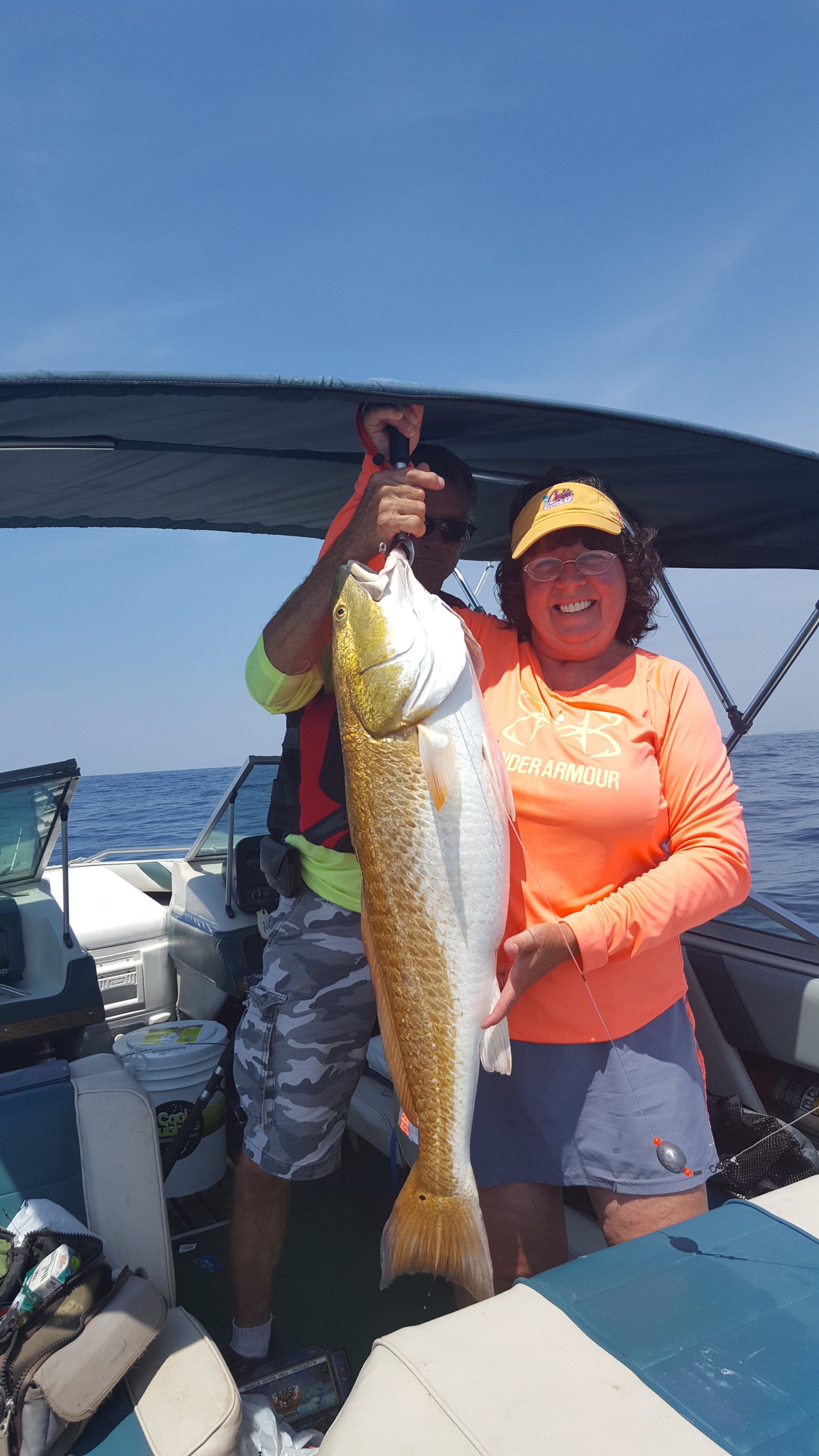 """Just east of the Destin Pass, Ruth Stokes of Baker pulled in a 35-inch, 25-pound redfish Aug. 25. """"Everyone thought I had hung on the bottom; I was exhausted,"""" Stokes said. """"He was over the slot limit and was released in good shape. Biggest fish I ever caught."""""""