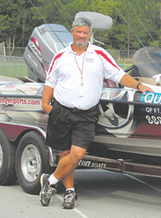 Ernie Martin with a boat from a local bass pro during the Outdoor Education class at Crestview High School.