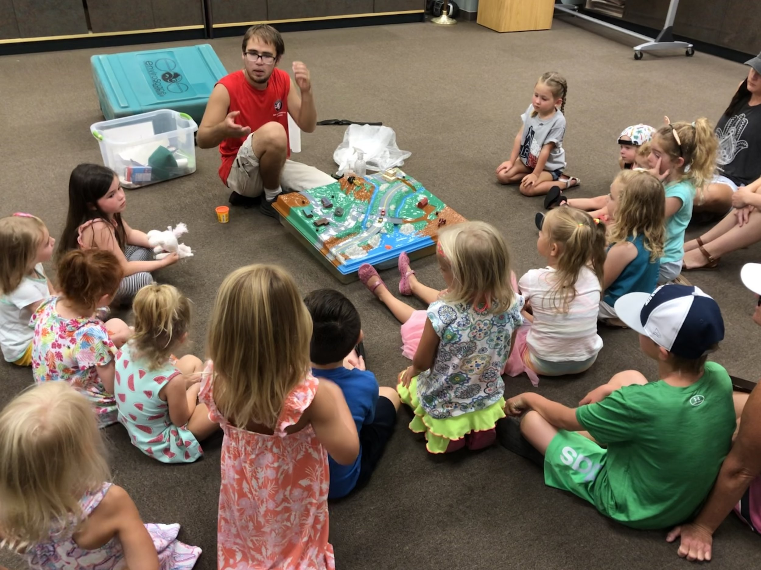 Representatives from the AmeriCorps/Choctawhatchee Basin Alliance Grasses In Classes program spoke with children as part of the Shelves to Shores summer series at local libraries.