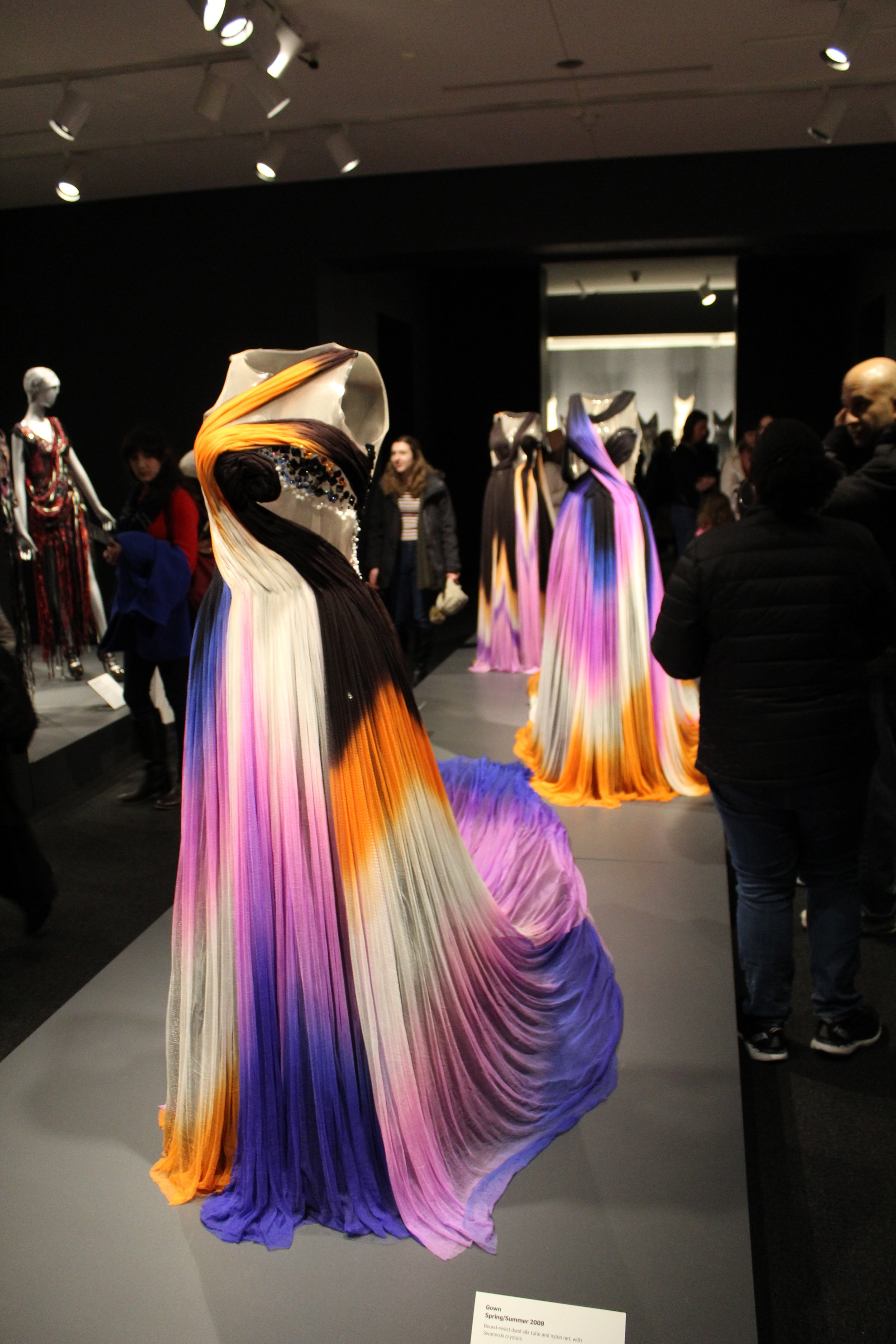 I enjoy the tie-dyed effect of the dress along with the impeccable detail to the front of the dress. Additionally, I'm always a fan of one shouldered dresses.