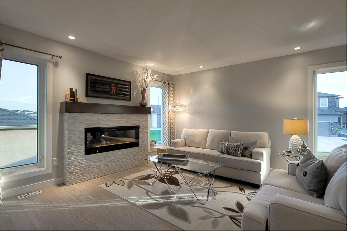03 - 1520sqft_Kendal ii_Great Room Fireplace_Bungalow_Sage Creek.jpg