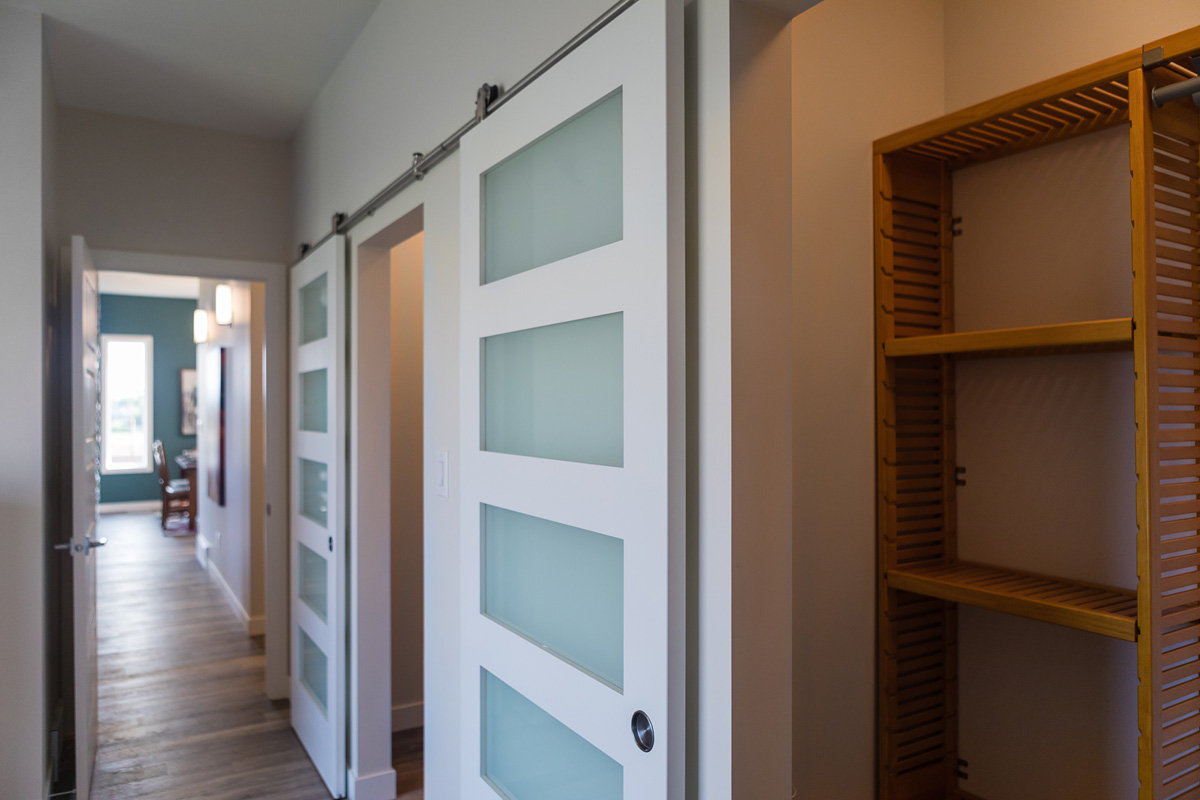 1775sqft_bergen ii_bungalow_interior_taylor farm_barn door closets.jpg