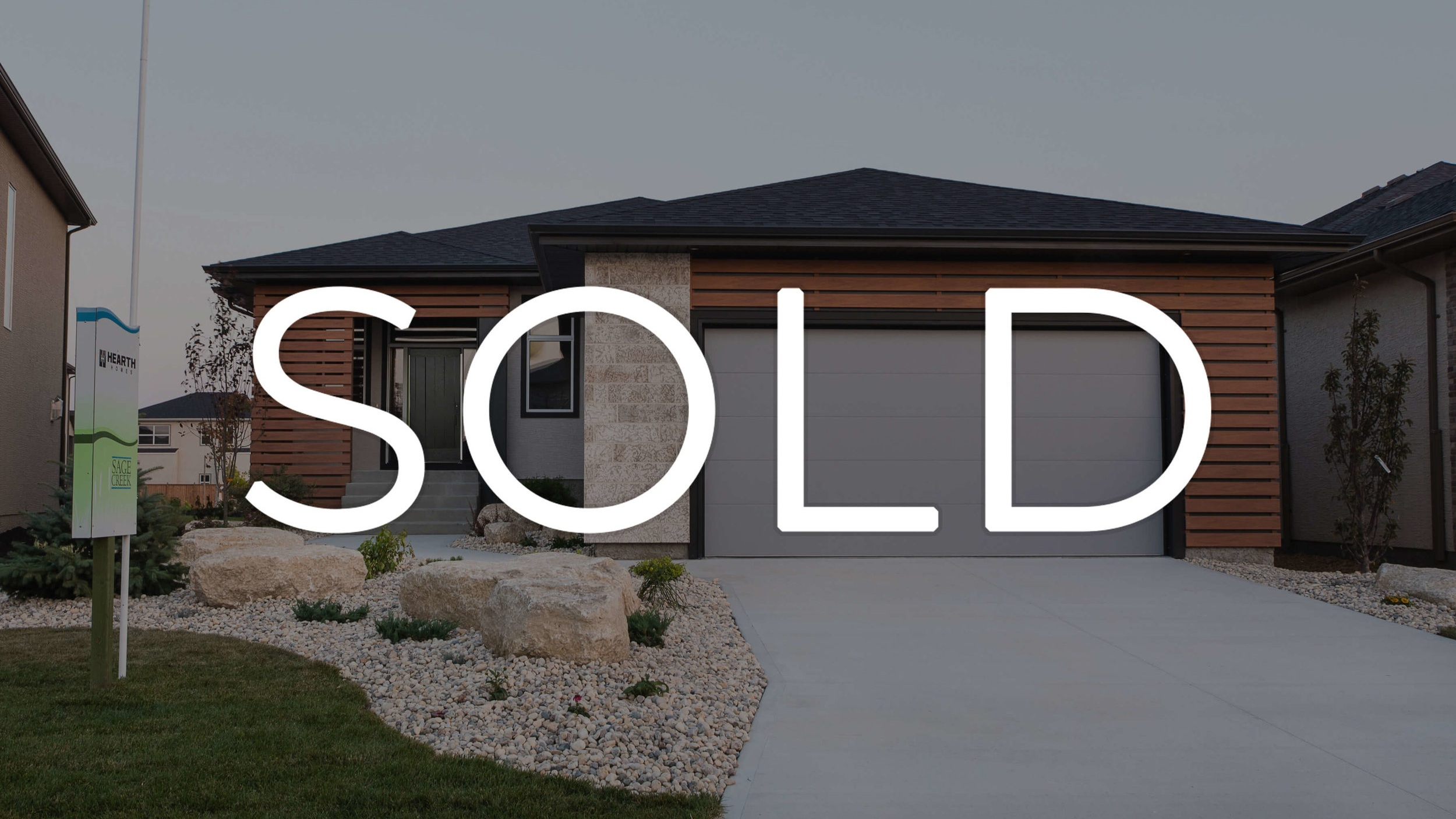 1815sqft_14+East+Plains_Exterior+Front_Bungalow_Sage+Creek_Sold.jpg