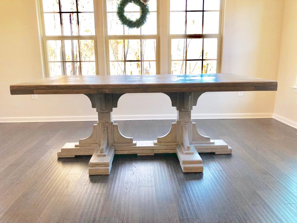 Statement-making table perfect for a large open space. $400 per linear foot Needs to be a minimum of 6' for this base. $400 per foot (6' table is $2400) .