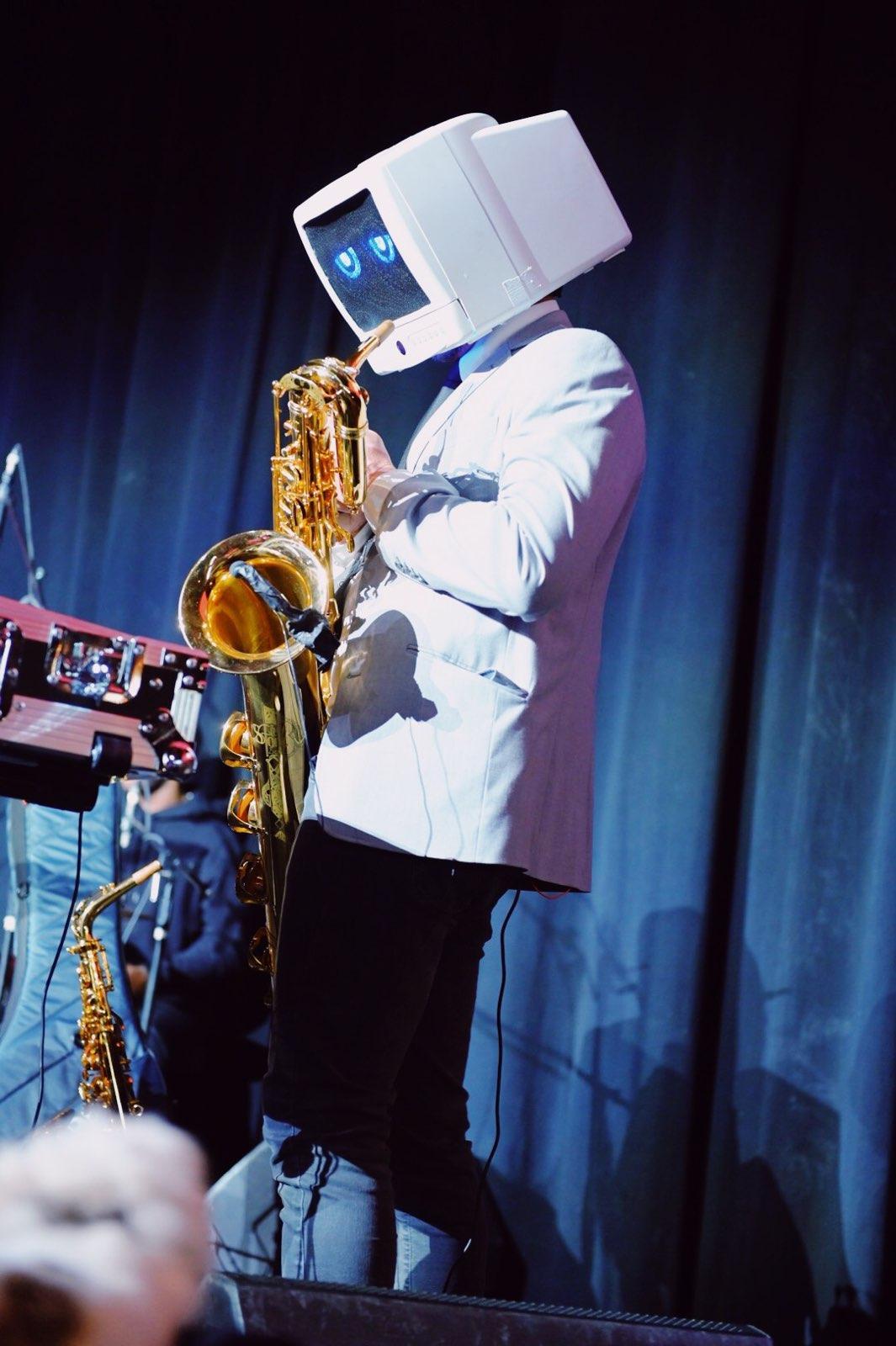 Robot DJ plays the saxophone