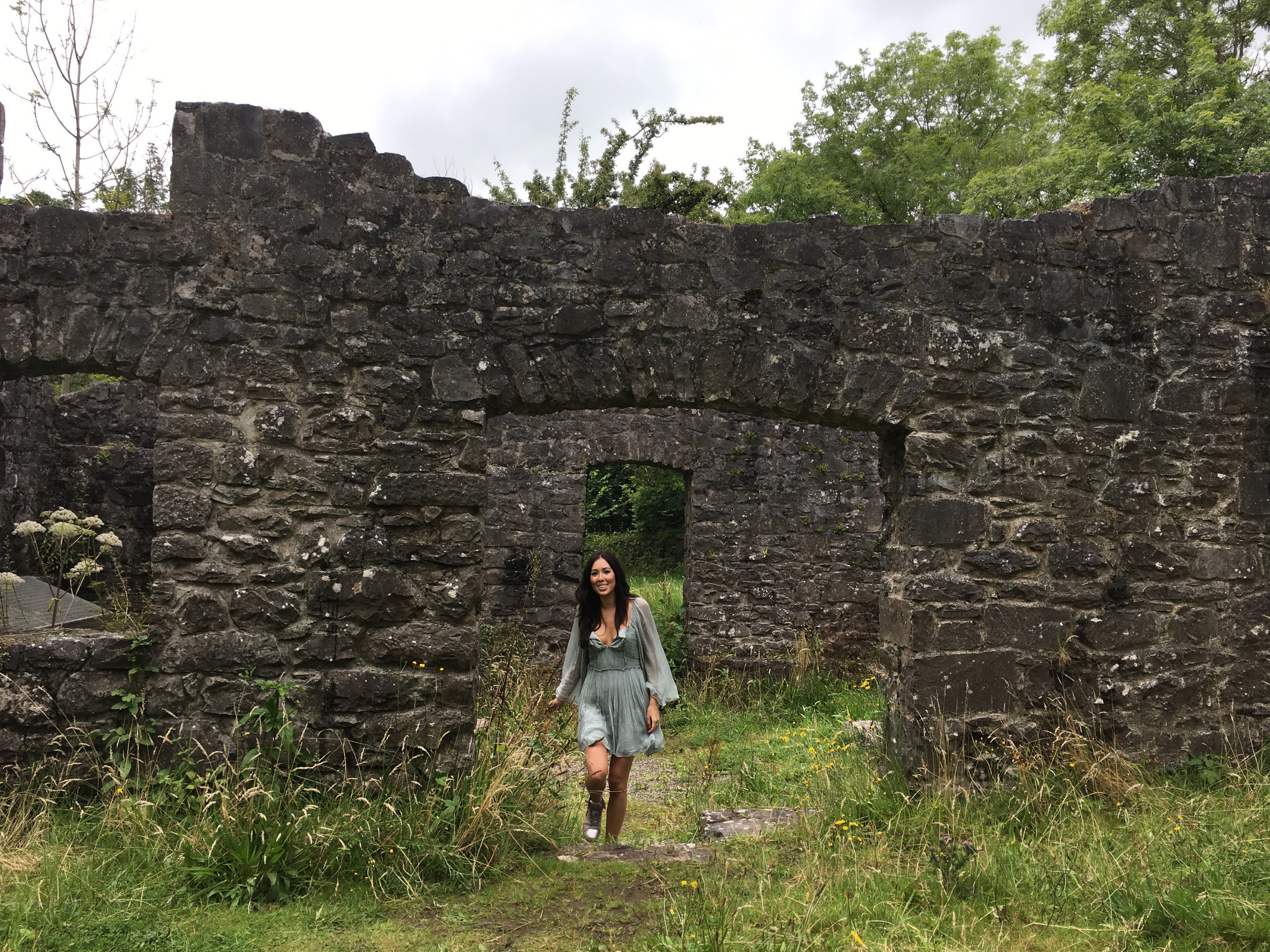 Exploring an old water mill on the grounds.