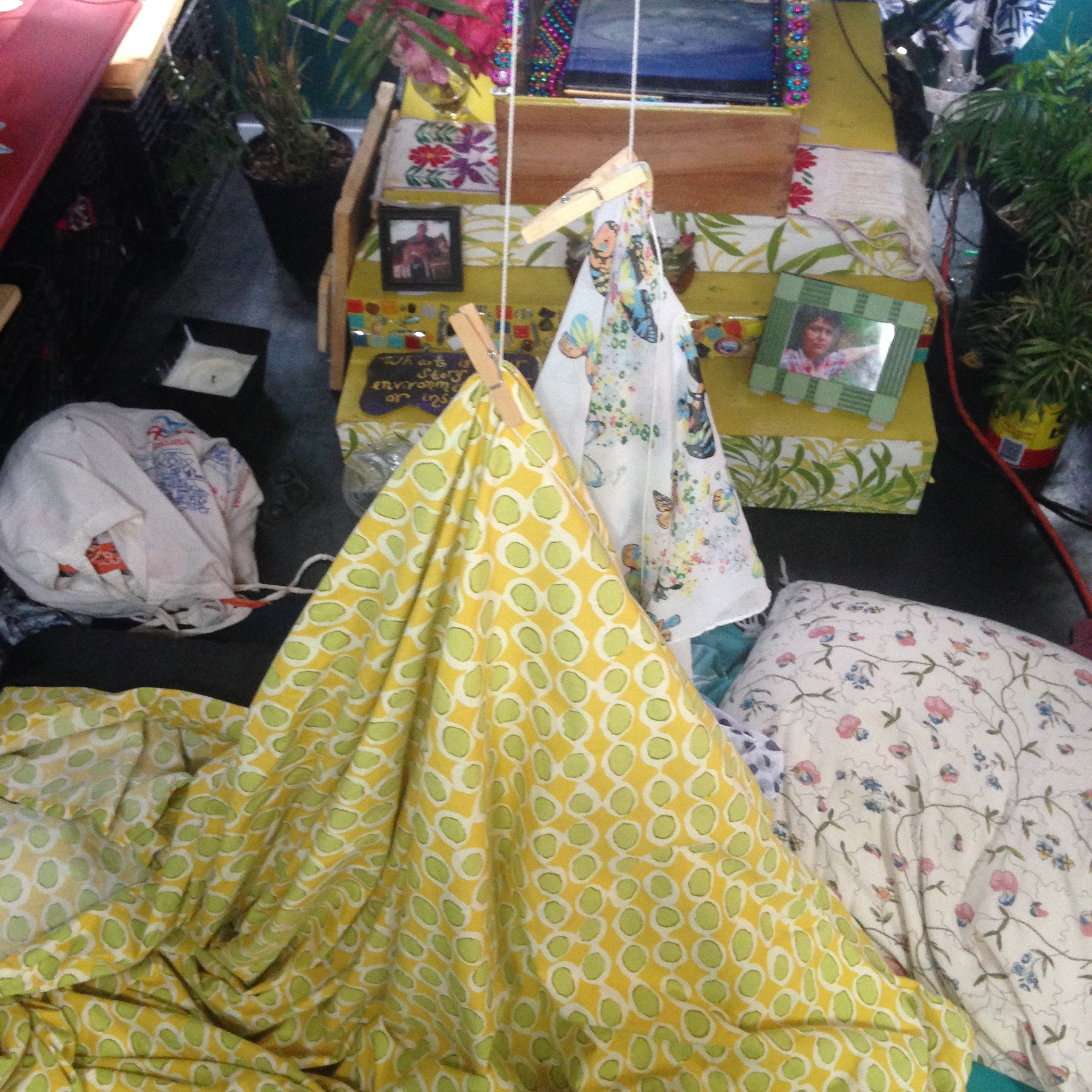 Sheet Tents, the new, the innovative mosquito protection! Sure to make you sweat, but there to protect! The Sheet Tent [patent pending].   Review: 3 out of 5 stars  Elena woke up in the darkness to Emma offering a hand fan. We were sprawled on our backs beneath a hand built sheet tent that was suspended from the ceiling with hooks, rope, and clothespins. We believed the sheet tent was working, and it was indeed keeping the mosquitoes out, but it was also keeping the fresh air out and the hot air in, on a 70 degree night. We laid, basking in our sweat, suffocating in our jailhouse sauna. Emma eventually evacuated to sleep on the roof of the bus one night, and, in utter desperation, on the sidewalk another night.