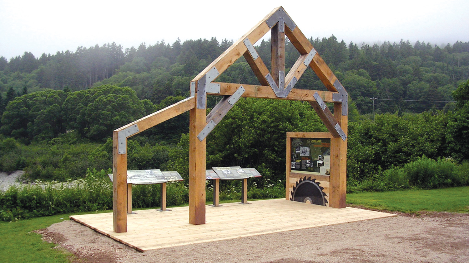 HISTORIC LOGGING HERITAGE Built structures and graphic panels at Point Wolfe evoke the park's historic logging heritage.