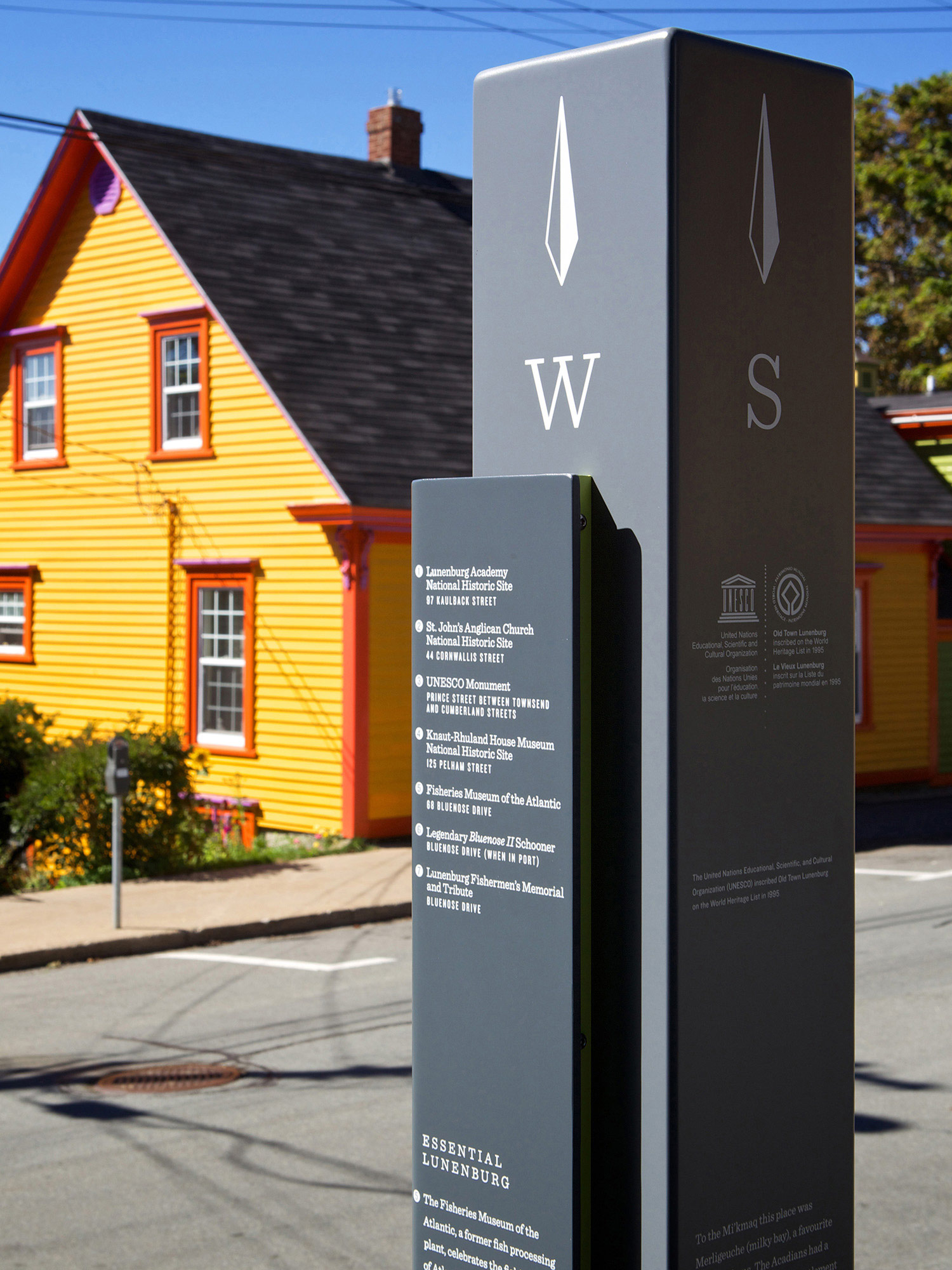 """CARDINAL DIRECTIONS These 6"""" aluminum posts, painted in two tones of grey, include cardinal directions and text establishing the significance of the UNESCO World Heritage Site."""