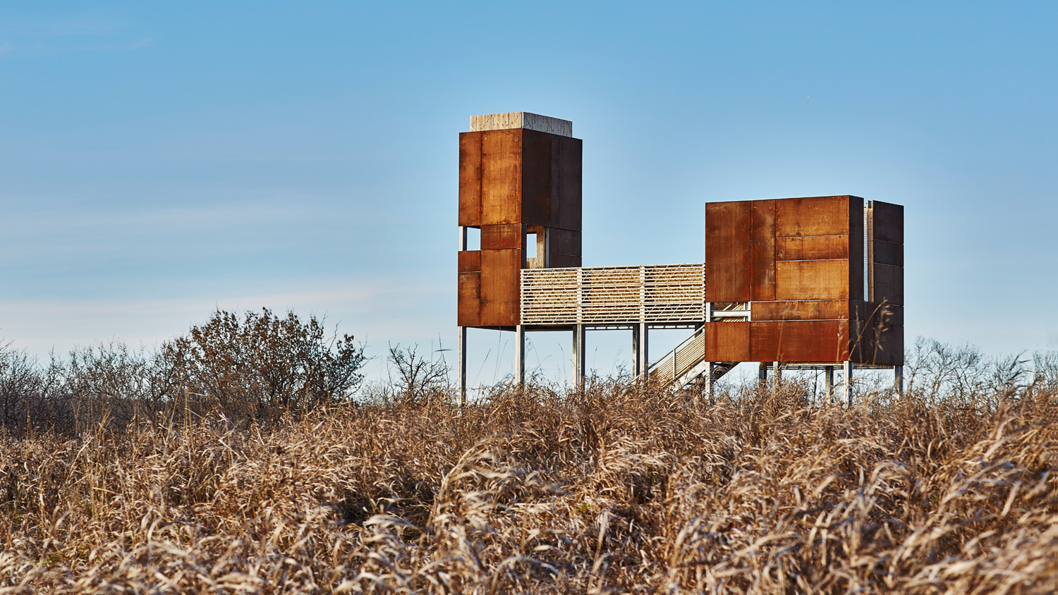 VIEWING PLATFORM  Floating over the landscape—overlooking the East Village and the river—the structure is comprised of two weathering steel bodies connected by a stage.
