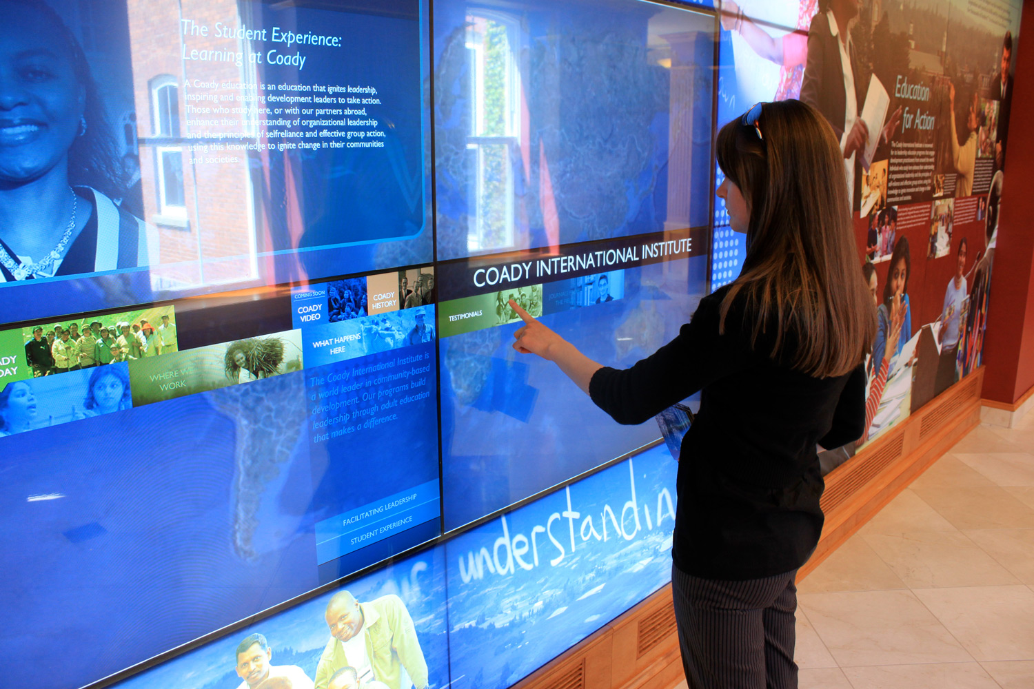 STUDENT EXPERIENCE AT YOUR FINGERTIPS A wall of touchscreens invites students to record impressions of their time at the Institute through video, and to retrieve testimonials and photos from previous students.