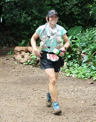 Marian Yasuda is such a rock star. This is how strong she was running after 80+ miles, coming into Paradise Park.  Photo by Andrea Stout.