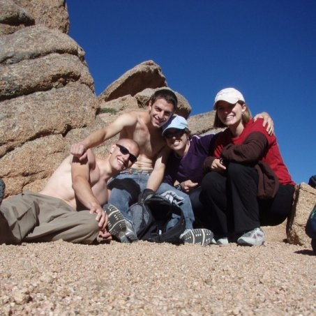 At the large rock formation, we pause for more carbs and another group photo. God bless trail mix!
