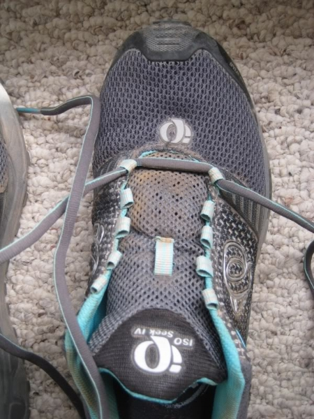 Start the usual way, with the laces strung through the first set of holes or loops.
