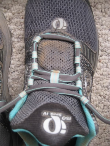 Then, cross the laces again until you've used up all but the top two holes or loops.