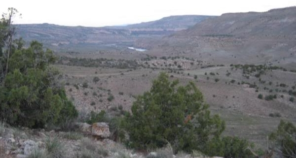 ...and here, looking northwest, our first glimpse of the Colorado River, as the climbing continues.