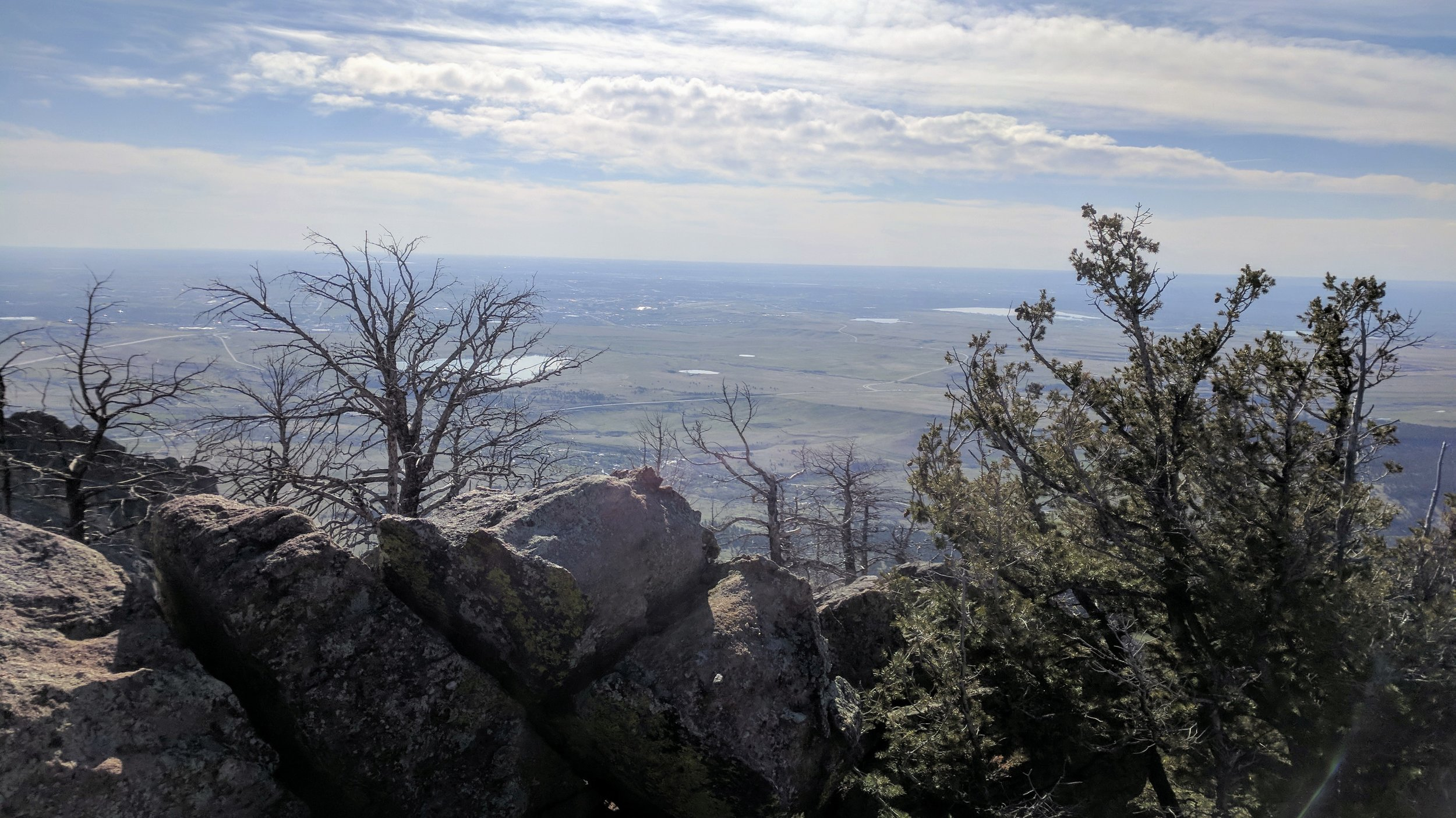 After a rocky scramble up the side of South Boulder Peak, tag the summit (8,549' -- the tallest of the Traverse) and enjoy the view over Boulder to the east...