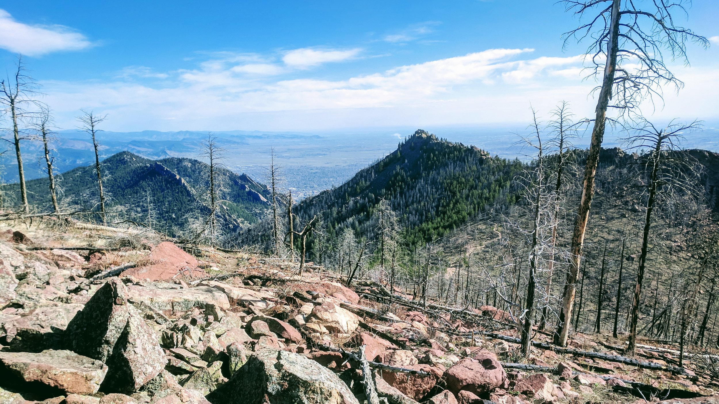After tagging the summit, retrace your steps back down this rocky north flank of South Boulder Peak to the trail junction, and continue straight up a few rocky switchbacks toward Bear Peak.