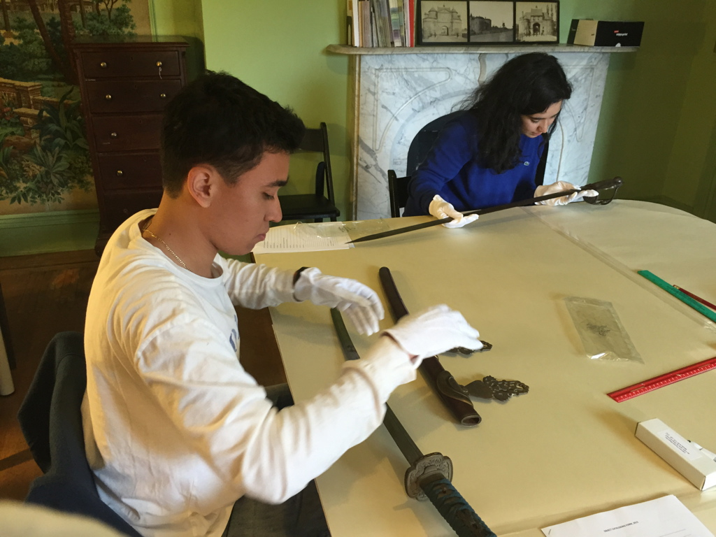 A. Garay and I. Altherr examine swords in the Evergreen Museum & Library collection at Johns Hopkins as part of a fall 2015 freshman seminar,  All About Things .