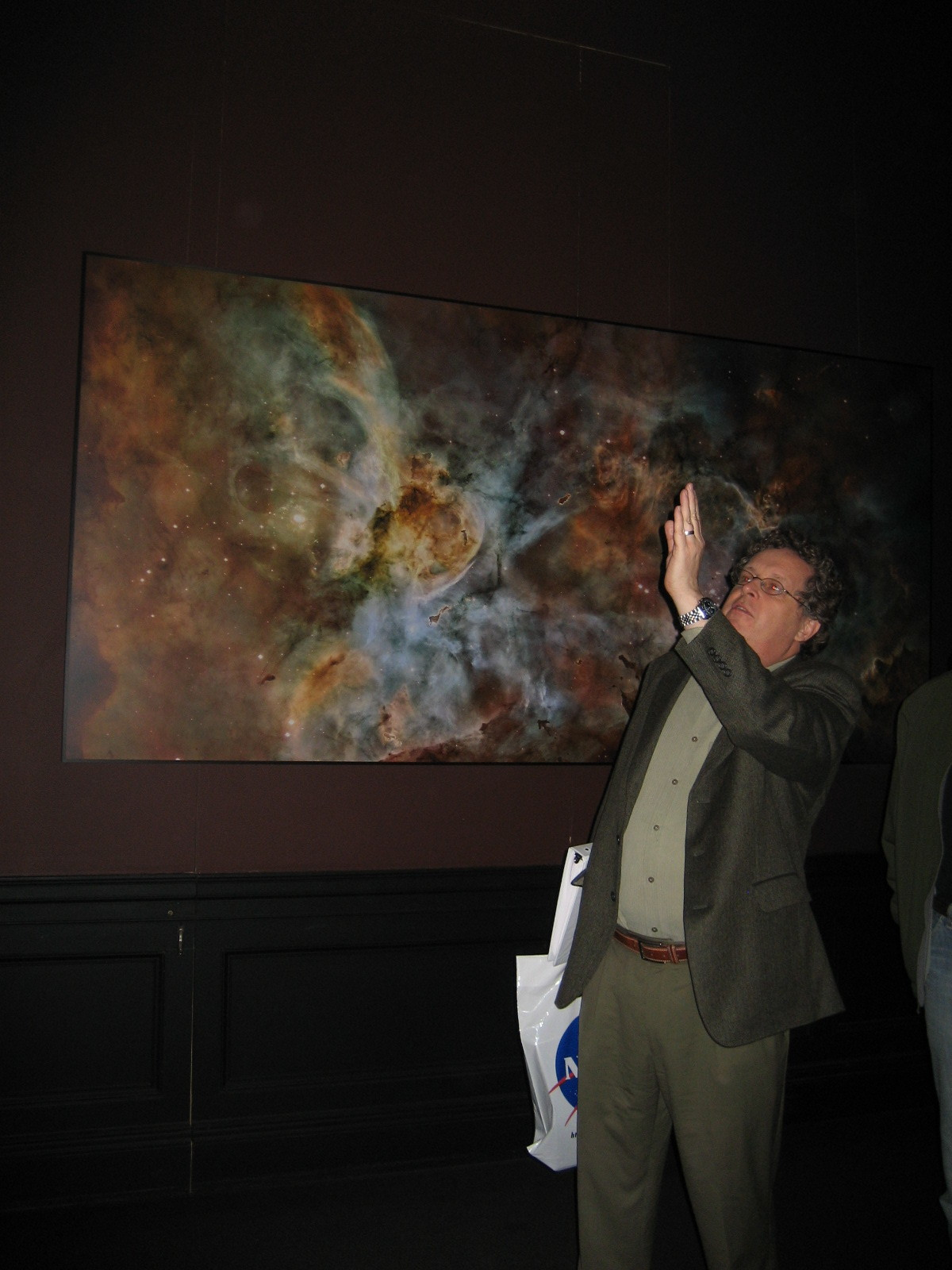 Dr. Matt Mountain, then director of the Space Telescope Science Institute, talks to student curators of  Mapping the Cosmos: Images from the Hubble Space Telescope  at the Walters Art Museum in 2008.