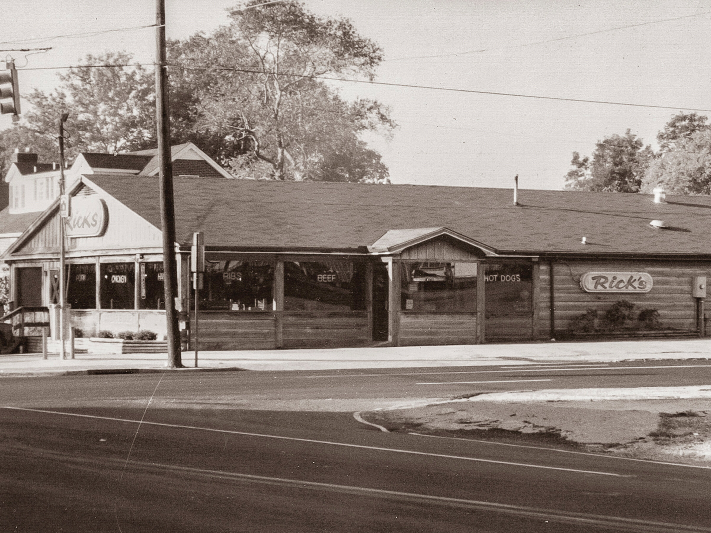 1979 - THE VERY FIRST RICK'S BARBECUE OPENED IN 1979 AT 401 WEST GAINES STREET, LAWRENCEBURG, TNTHE LOCATION ORIGINALLY OPENED AS WALK UP / DRIVE THRU LOCATION AND ONLY HAD 2 SMOKE PITS. AS YEARS PASSED, A COVER PATIO WAS ADDED AND THEN ENCLOSED TO ALLOW AN INDOOR DINING AREA