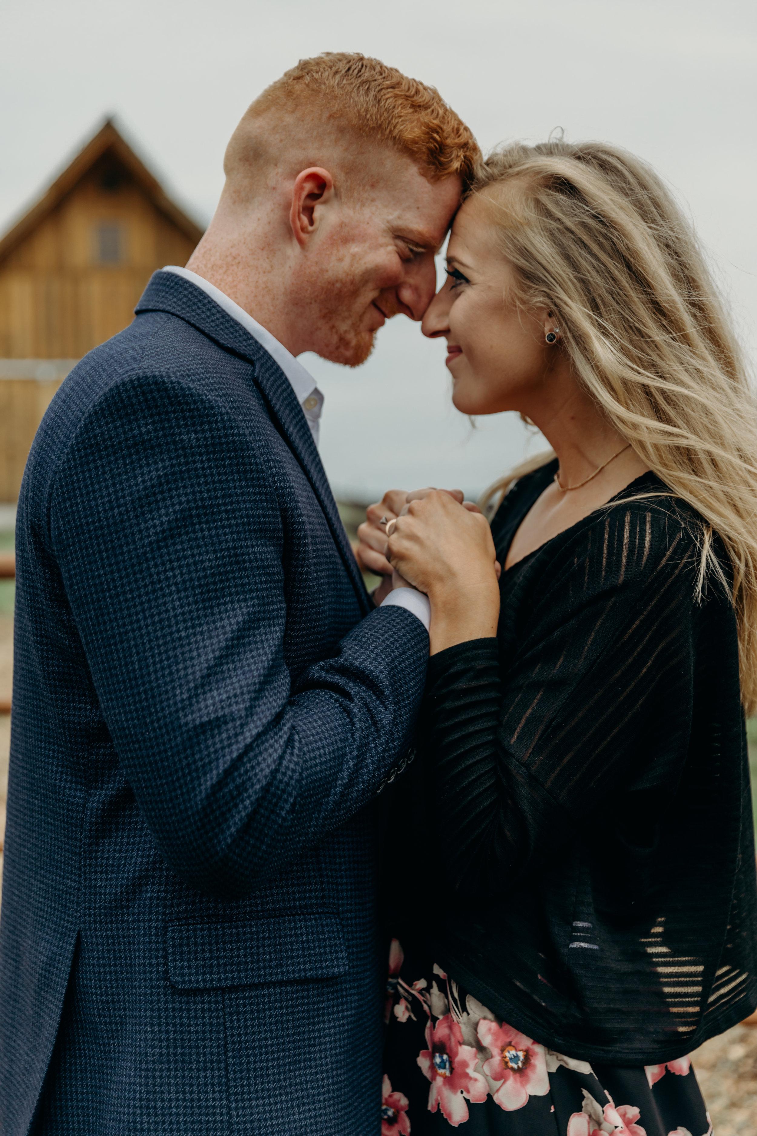 Tyler&KarolineLouisburgCiderMillEngagementSession-24.jpg