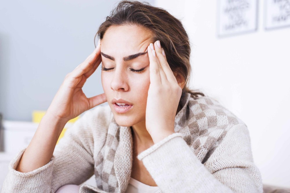 Woman With Migraine Headache At Pearson Family Chiropractic In Palm Coast Florida