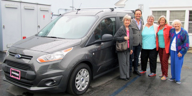 Members of Women's Fellowship with Nick Rasmussen of Family Promise of the South Bay and the commuter van that they purchased for Family Promise in 2017. The van replaced a older van in need of repair and allows students and parents to get to school and work safely and on time.