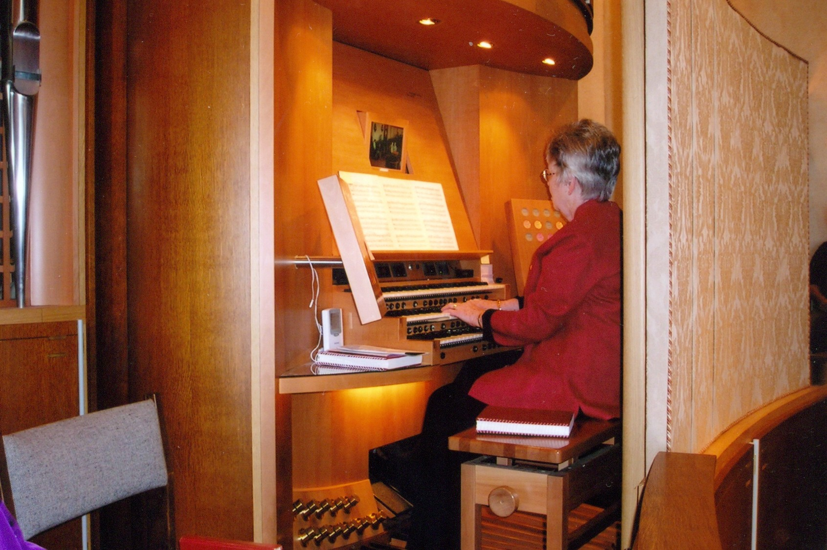 Becky playing organ during a Sunday worship service
