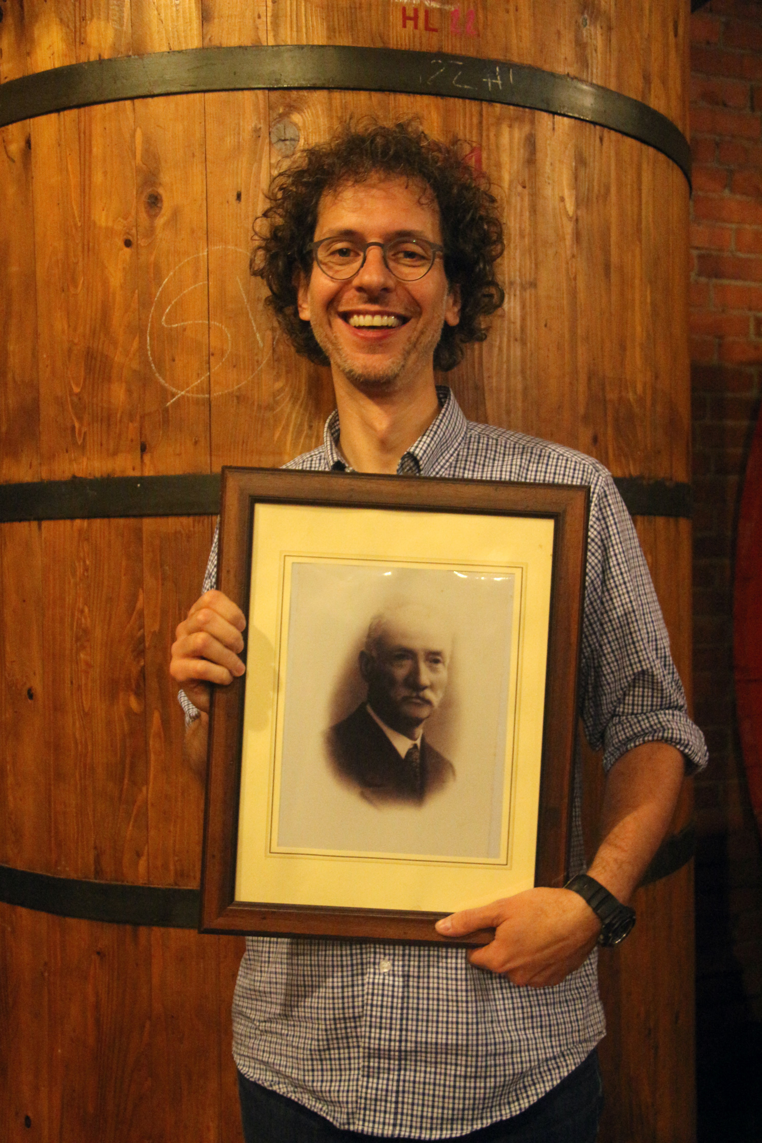 Augusto Cappellano with a portrait of his great-uncle Guiseppe