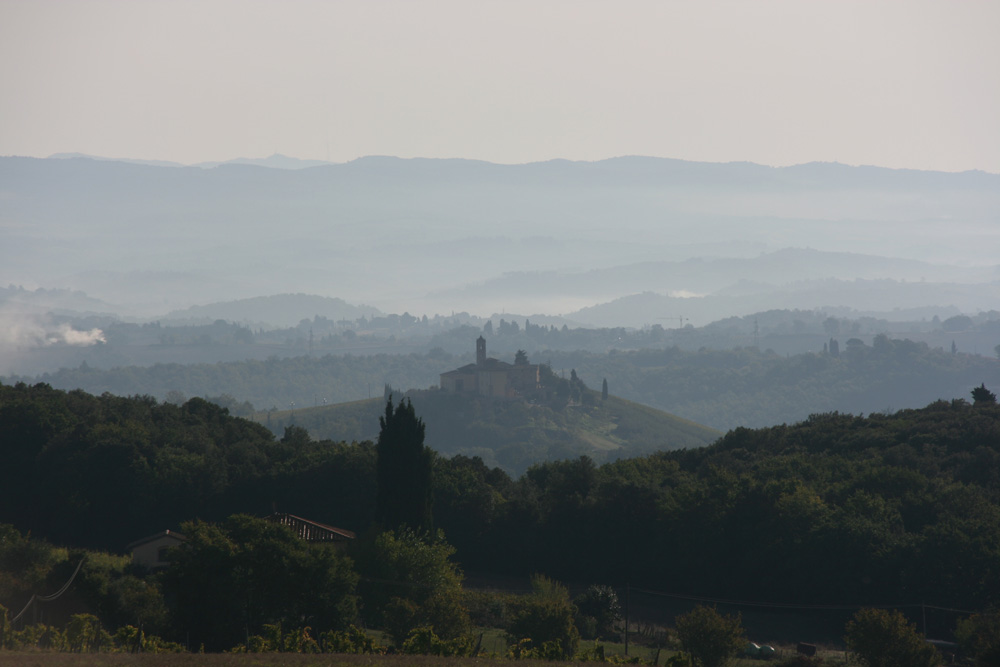 Early morning mists in the hills around San Gimignano
