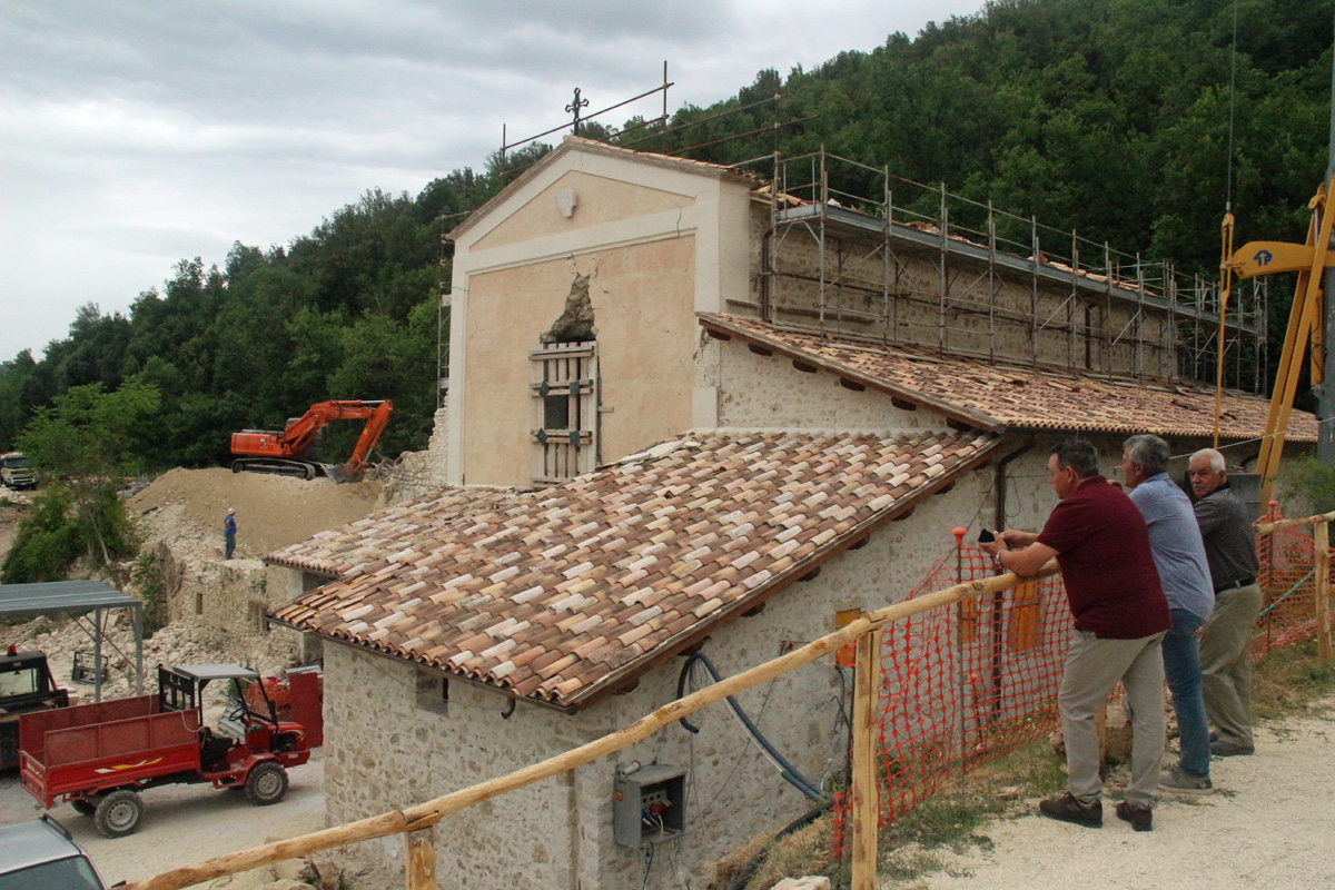 Clearing rubble from the old Franciscan church and convent, where the monks will begin anew.