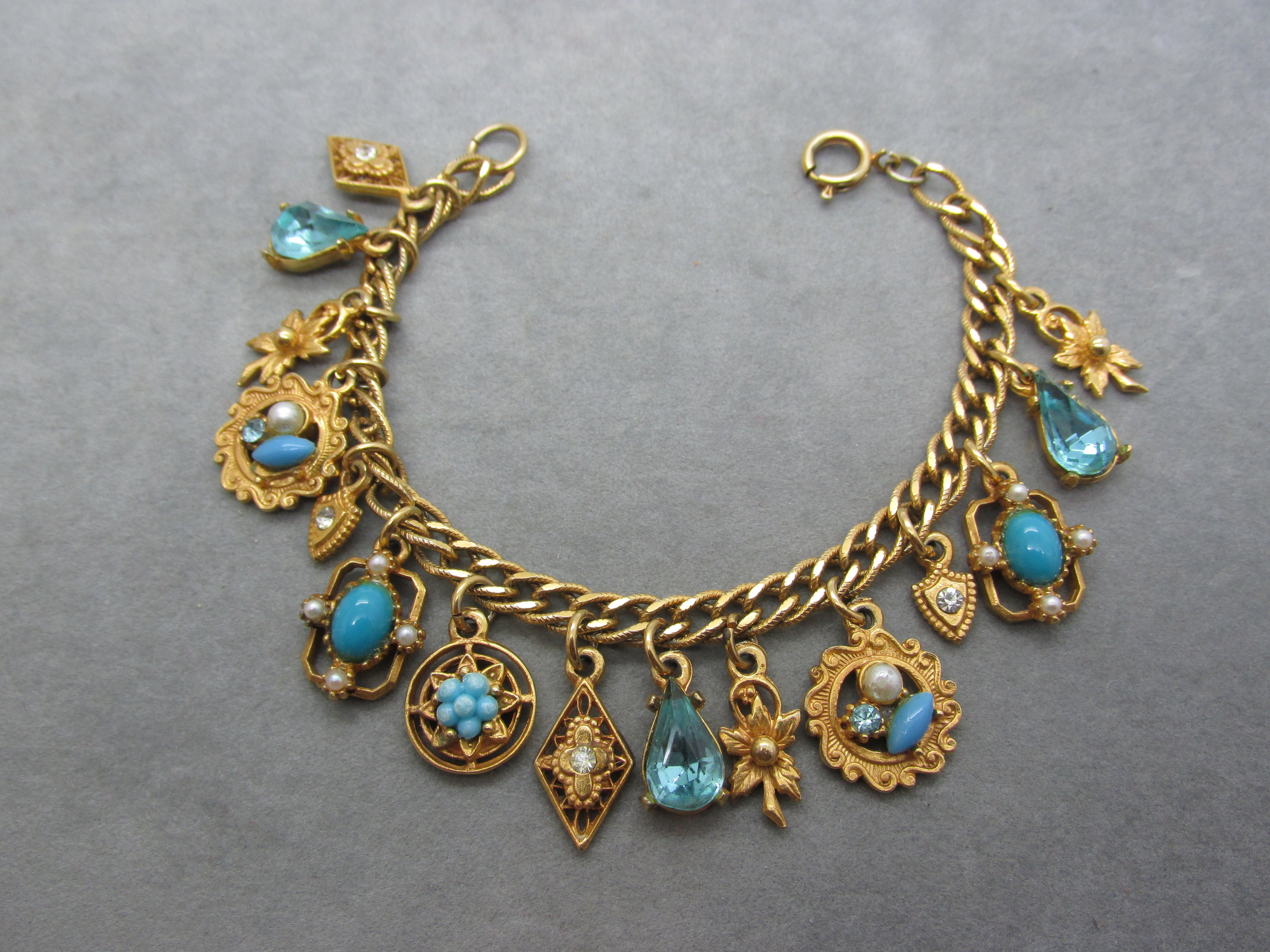 - Aaaah the 1950s, when soda Fountains, letterman jackets, and charm bracelets were all the rage. This vintage beauty has Turquoise Blue rhinestones and faux pearls and is in excellent condition. Available here in my shop or my ebay store. (click here to view). Come see what's new this week at MARQUIS ETC.