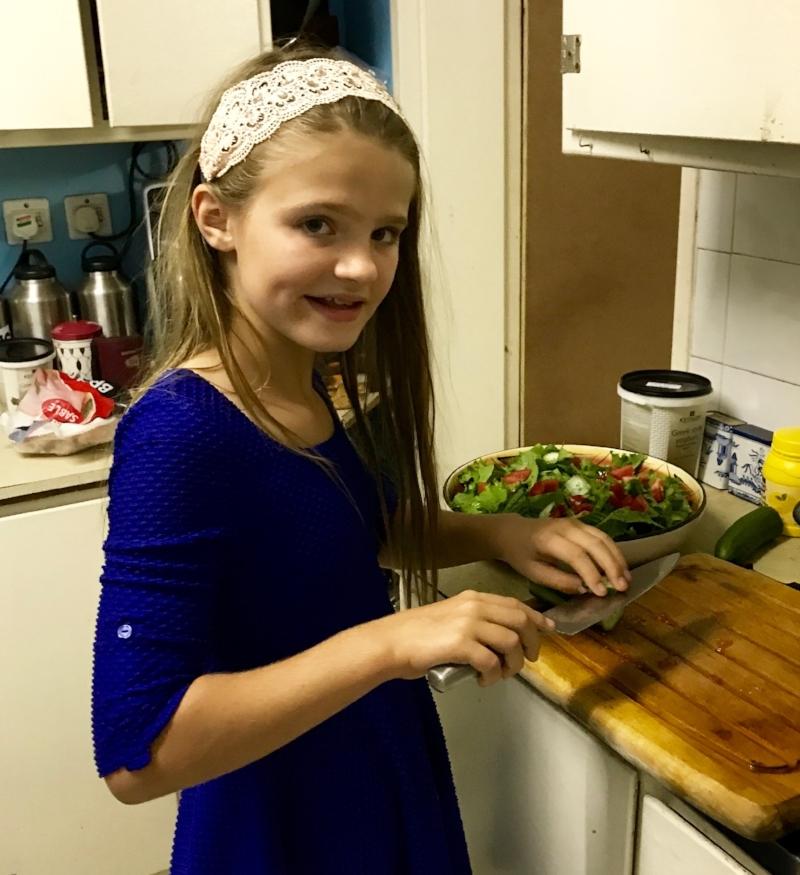 Isabelle prepares a salad in Chiredzi