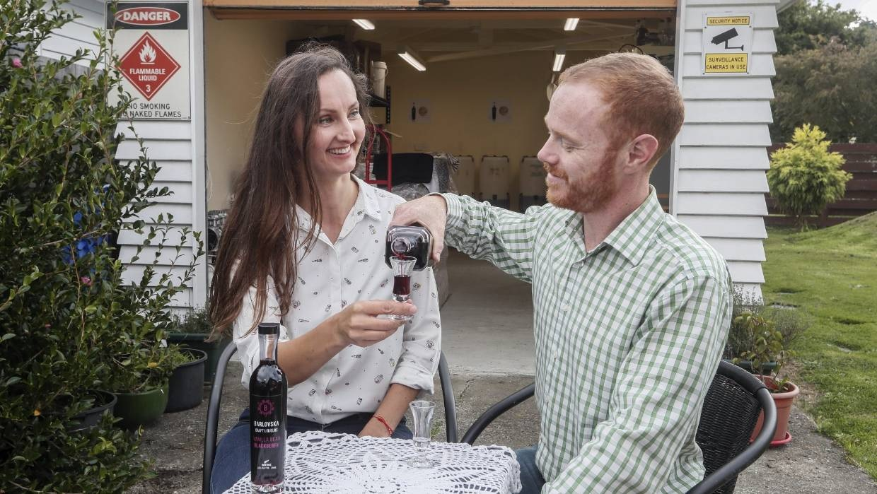 Barlovska co-founders Zuzanna Chmielewska-Barlow and Chris Barlow share a vanilla bean blackberry liqueur produced in their garage.  photo: Kevin Stent/STUFF