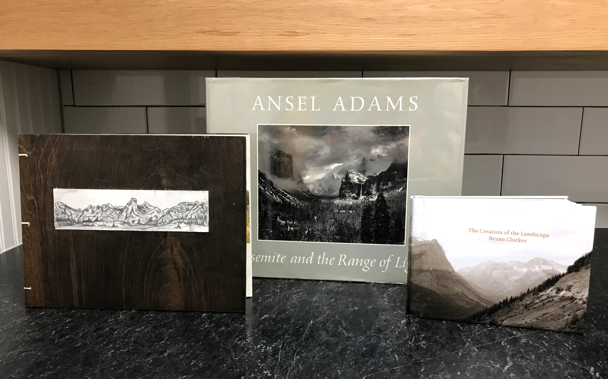 The two books I made along with my most prized Ansel Adams books. From left to right;  The Grandeur of Wyoming, Ansel Adams Yosemite and the Range of Light, The Creation of the Landscape.