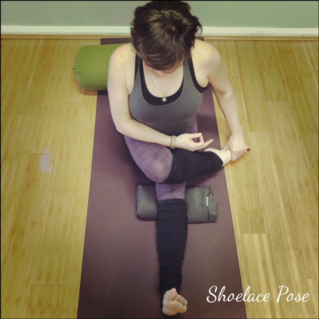 Bottom leg straight – half shoelace pose. Support the hamstring in the straight leg to avoid hyper-extension.