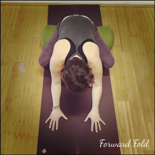 Sit on bolster to ensure forward pelvic tilt before folding forward.