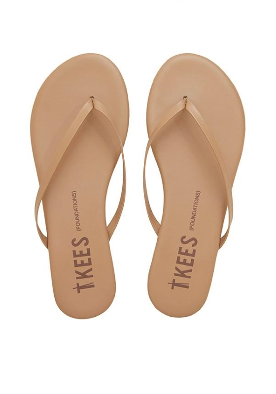 Nude Flip flops - Easy to throw on and go! Not only do they go with everything, but they'll make your legs look super long!