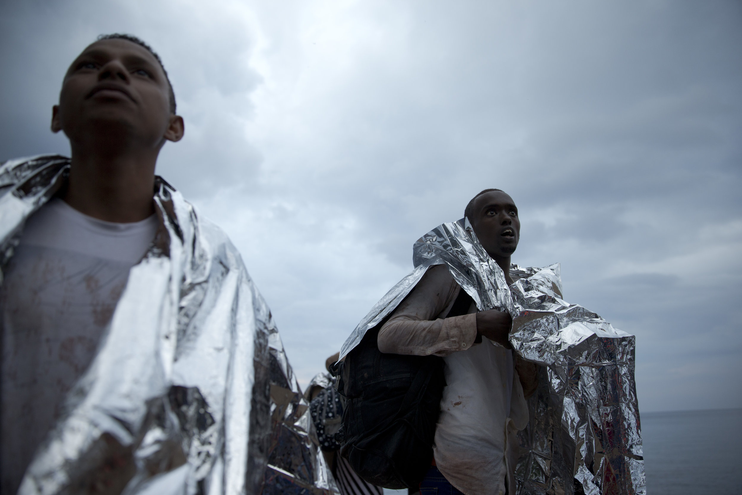 refugeesboatsEXTRA.jpg