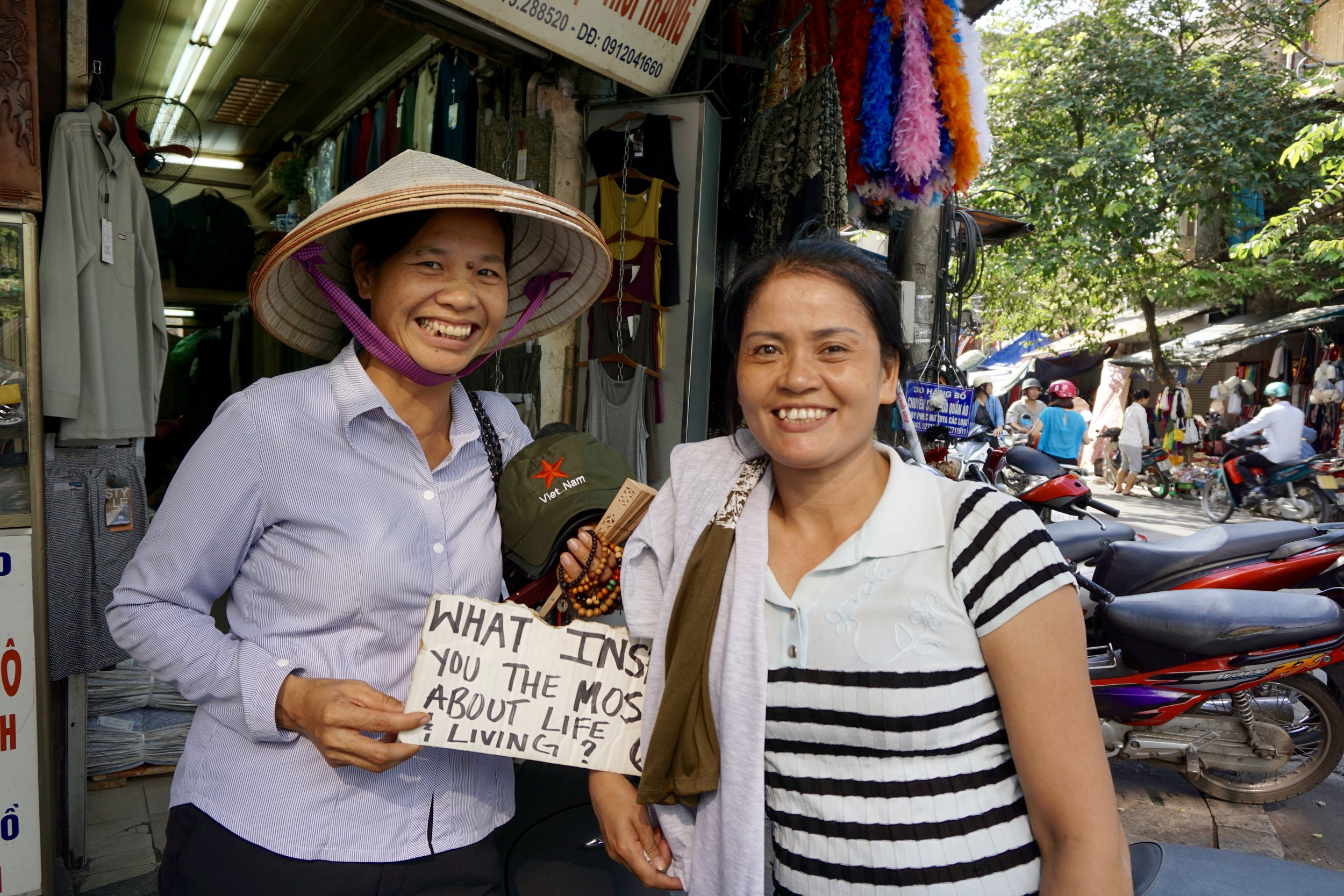 """From : Hanoi, Vietnam   Interview Location : Hanoi, vietnam  """"... our family. We both travel 2 hours everyday to work ( the city) to try and make enough money to bring to our family. We have children and we just try to make enough to to send back for them to go to school...it's very difficult so we work very hard, because we make very little..."""""""