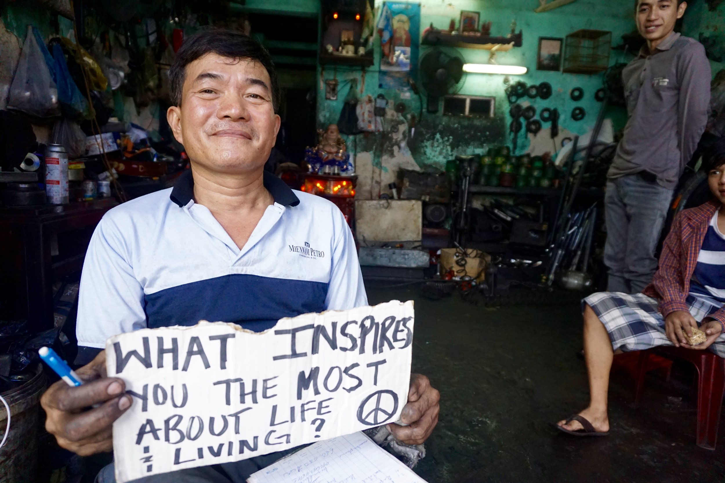 "From  : Vietnam   Interview Location  : Hoi An, Vietnam  "" When I will repair your motorcycle very carefully…when I help the foreigner's I am really happy! I think when the foreigner's come to Vietnam they're going for local help. I think when I have time I will Vietnam and go live in California with my younger brother. I will meet foreigner of America to help me. I think like this, I help you help me…"""