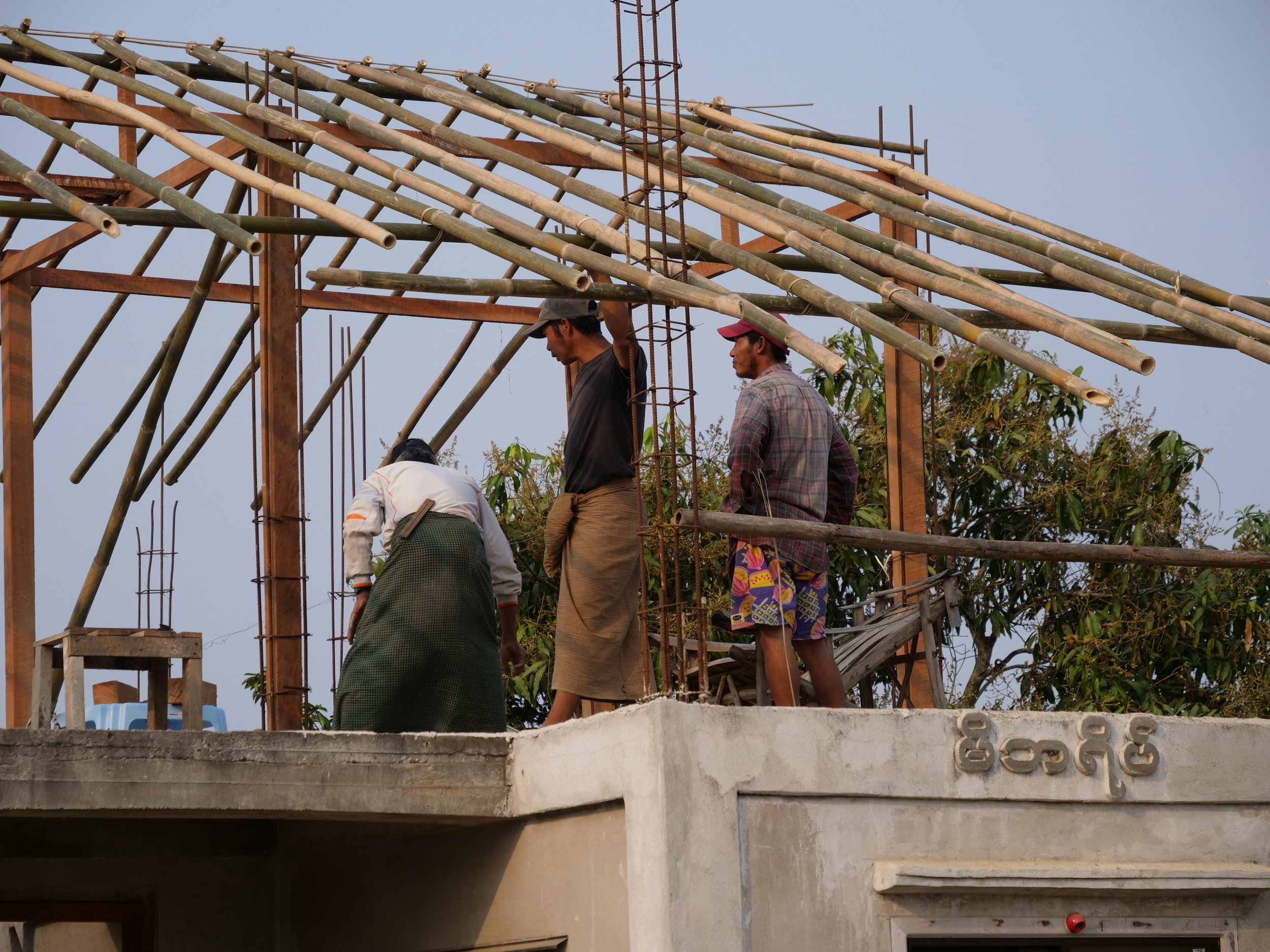 Local craftsmen assembling our office roof